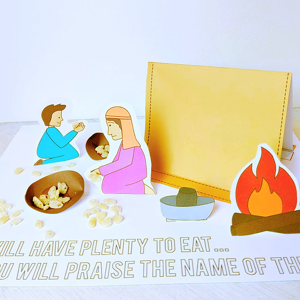 scene fo woman and child picking up manna made out of paper