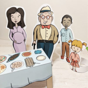 image of color crafts people standing next to a table